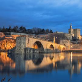 View on Pont d'Avignon 12th century bridge and city skyline refl